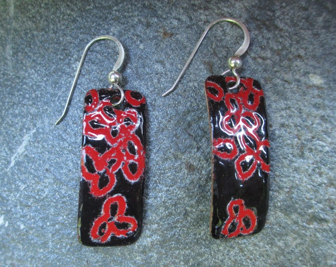 Black and red sgraffito enamel earrings with a floral design and sterling silver ear wires