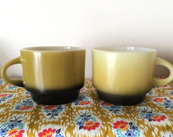 sale--set of 2 Fire King two tone olive green & black mugs