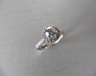 Diamond set solitaire ring