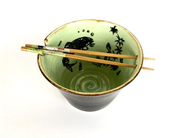 Handmade pottery bowl noodle pho soup with green fish