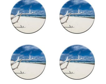 A pack of 4 driftwood on white sandy beach Pattern weights Ideal for weighing down patterns on delicate fabrics no need for pins