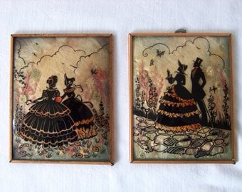 Pair of Silhouette Convex Glass Reverse Painted Pictures with Copper Frames