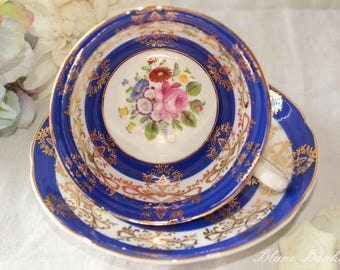 Royal Grafton, England: Blue tea cup and saucer with colorful flowers
