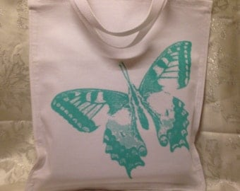 White Linen shopping bag with butterfly motif.