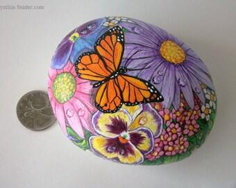 Painted rock,painted stone,flower rock,painted floral rock,monarch butterfly,pansy,gerbera daisy,purple flower,flower basket,garden decor