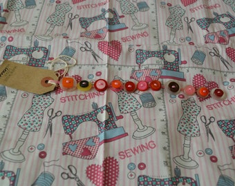 Colourful, pink, brown, orange, yellow, button bracelets.