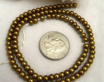 Strand of 4 mm Glass Pearls - Polished Brass (1956)