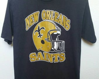 Vintage 80s New Orleans Saints Football T-shirt, Thin Lite Soft, Fitted Size Large, 80s Team Logo, small marks, see photo detail.