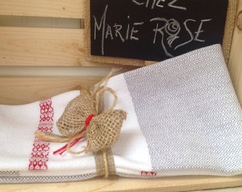 Towel low style of grey red white wool completely woven by hand a Quebec
