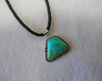 Beautiful #8 Mine turquoise with leather Cord....