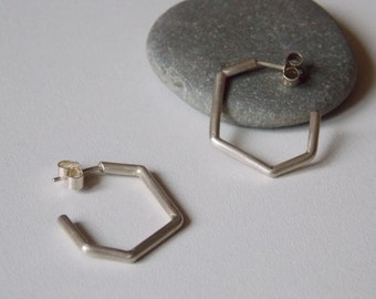 Silver earrings of geometrical forms. geometric hoops for women.