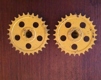Pair of Large Yellow Tractor Gears or Sprockets - Industrial