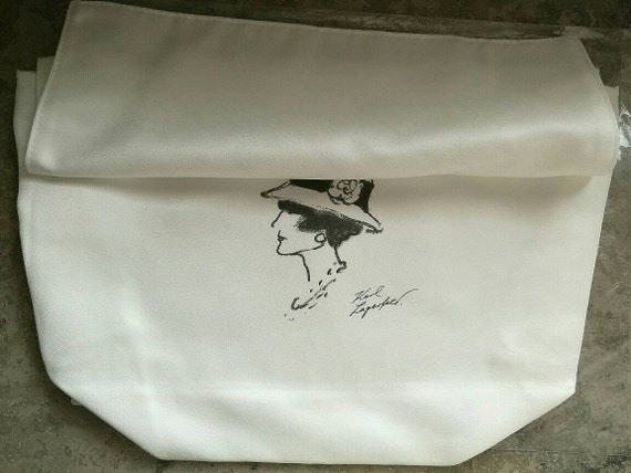 Size S Chanel white tone dust bag, bag protection designed and signed by Mr. Karl Lagerfeld