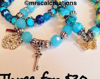 Trio of blue beaded bracelets
