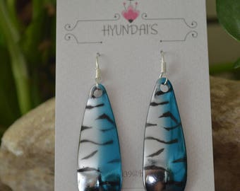 A pair of gorgeous fish earring's,With blue Black and silver.