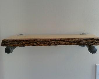 Live edge shelf on pipe