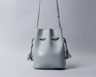 Minimalist Womens Genuine Leather Crossbody Mini Bucket Bag with Tassel