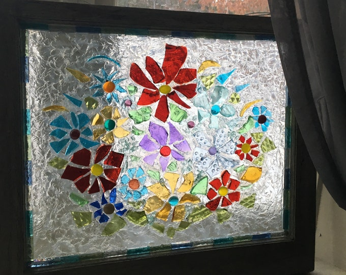 Old window decorated with various glassware