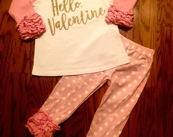 Hello, Valentine outfit set for infants, toddlers and girls. Ruffle raglan tshirt, polka dot pants with glitter Valentine's Day saying.