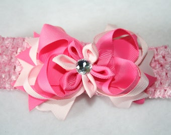 Boutique Ribbon bow on a crocheted Interchangable  headband......  Beautiful Pinks on Pink...