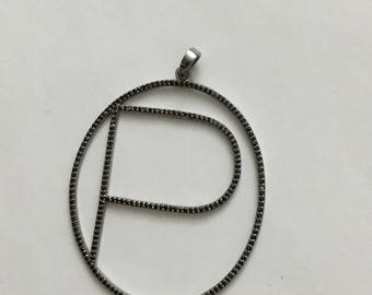 Pave black spinal sterling pendant