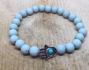 Pastel turquoise bracelet with hamsa hand