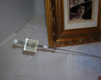 This is an Antique hatpin like you have never seen before