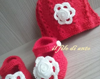 Red wool hat and booties with white flowers