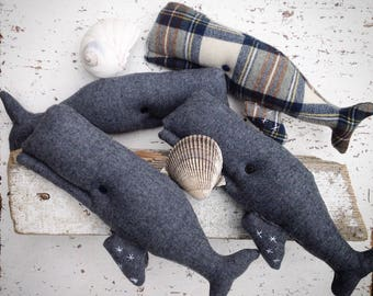 "Whale manimals! from recycled wool sweaters, blankets and men's suits. This pod comes complete with ""barnacles"" on their flukes."