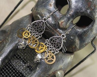 Steampunk skull earrings with antique gears