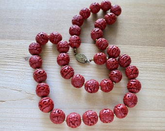 Vintage carved cinnabar bead necklace with gold tone spacer beads - 26 inches long