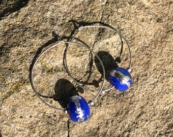 Large hoop earrings with bright blue and silver beads