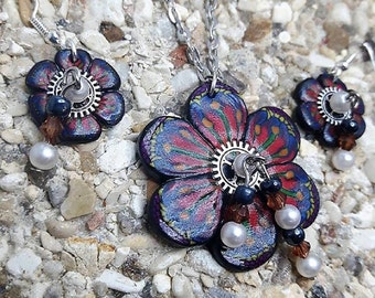 Ornament blue and red flower in fimo steampunk and pearls
