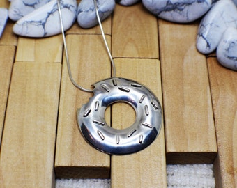Sterling Silver Pendant in the shape of a doughnut