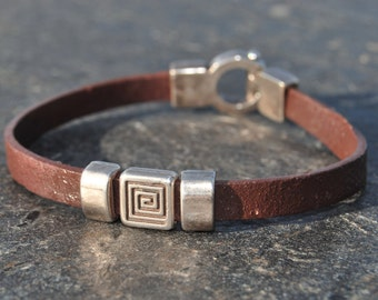 Male bracelet in brown leather and silver