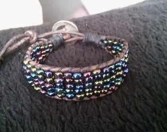 Bracelet made with Rocailles seed beads and leather.