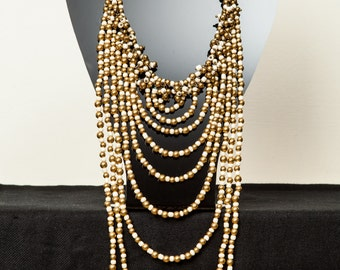 Stunning bronze and white beaded necklace.