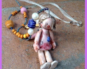 """Collana in ceramica con bambolina:"""" la Parrucchiera""""/ Clay necklace with little doll """" Hairdresser"""""""