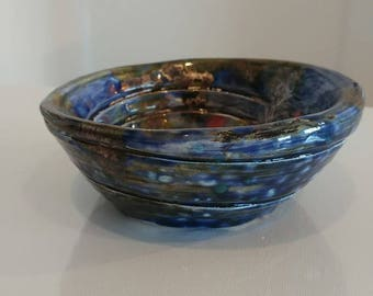 Blue and copper glazed swirl pot.