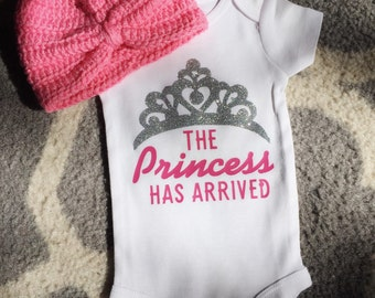 Newborn onesie the princess has arrived. Beanie not included