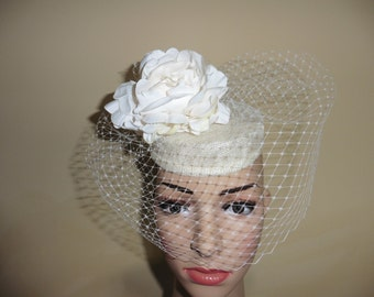 Ivory pillbox.Ivory Small Hat.Ivory Wedding Hat.Ivory Race Hat. This is a small Ivory Pillbox with ivory veil and large ivory flower