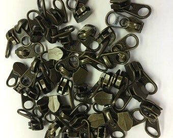 AM020- Antique Brass Look Zipper pulls.  50 ct.