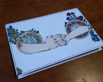 A gesture among flowers card