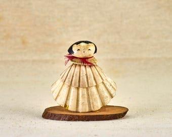 Small Japanese girl made of seashells. Vintage Japanese figurine
