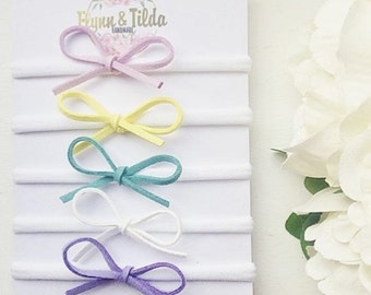 Any 2 baby headbands dainty bows in spring colours