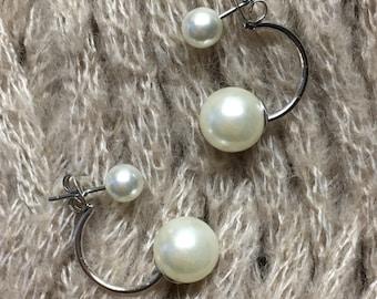 Double earrings.