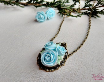 Elegant handmade jewelry set (stud earrings and pendant) with light blue roses