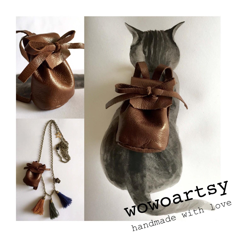 Collier voyage avec le chat mini sac dos cuir agneau - Cuisiner le collier d agneau ...