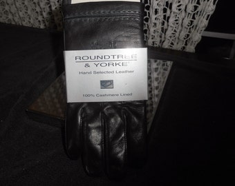 Awsom pair of black leather GLOVES    100% CASHMERE LINED  with tags
