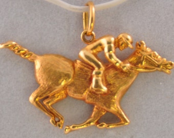 A Jockey on a Running horse made from 14kt Gold
